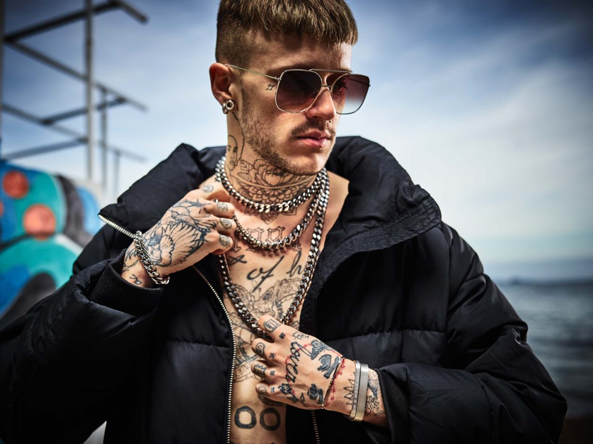 Regalia luxury heavy Octogone hip hop chain bracelet and choker, short and long necklaces and Le R solid 925 Sterling silver bangle bracelets, on tattooed model wearing grills