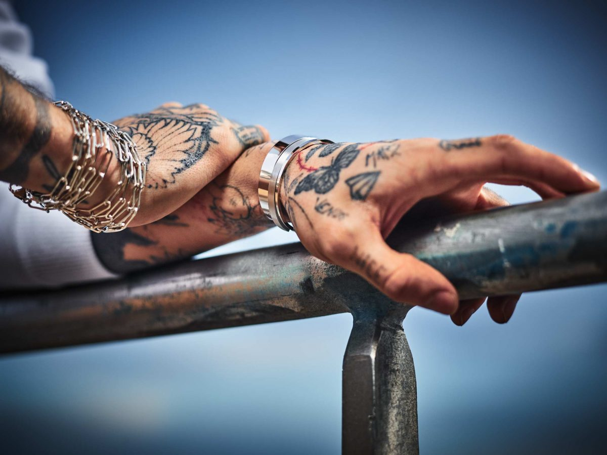 Regalia solid 925 Sterling silver chain bracelets from Logo collection and bangle bracelets from Renaissance collection worn by tattooed model